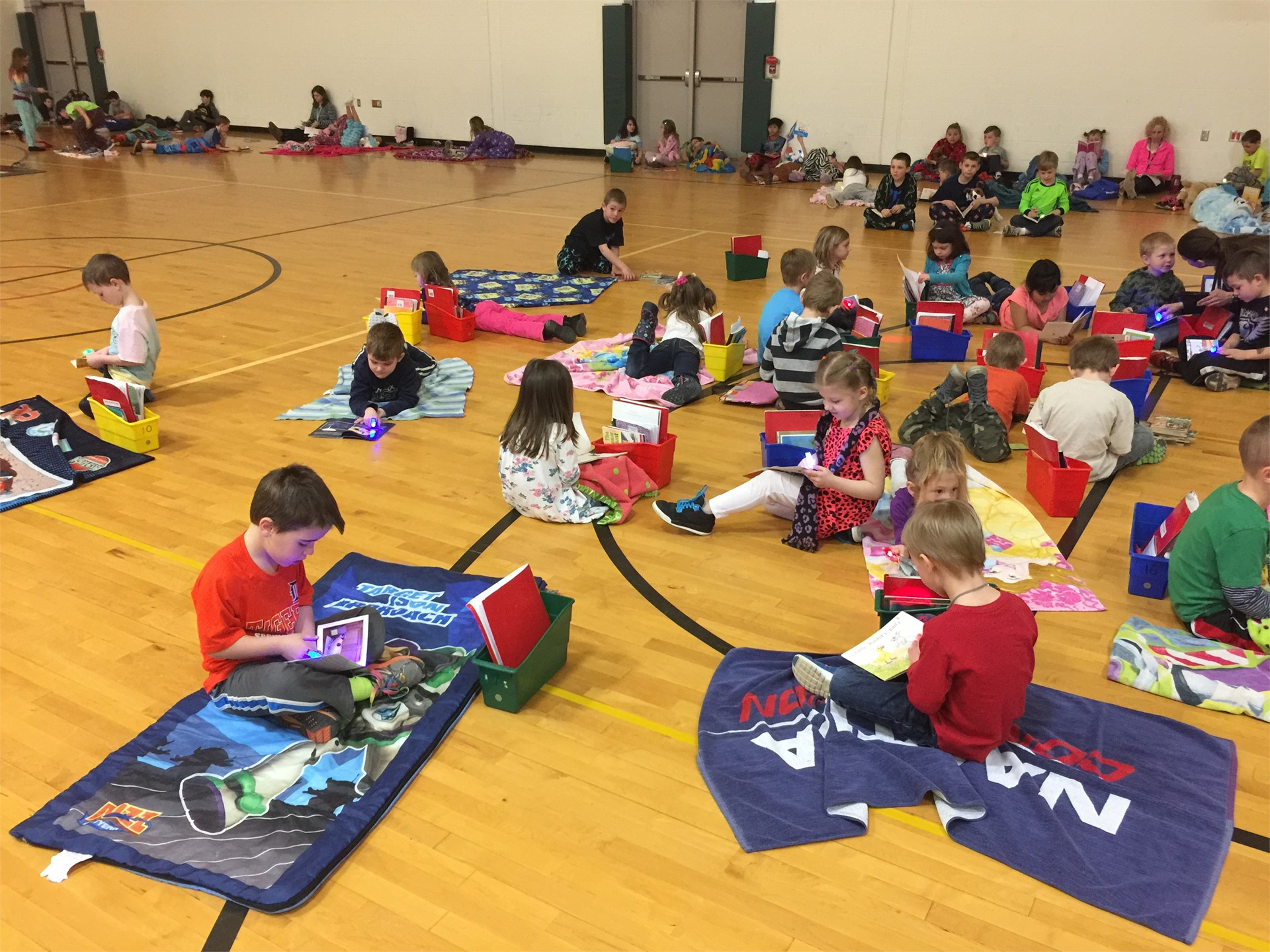 Students reading on their comfortable mats